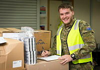 Australian Army soldier Corporal Kynan Williams, a Class 8 storeman with Force Support Element 5, unpacks medical supplies at Australia's main Operating base in the Middle East region.