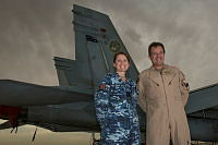 Commander Air Task Group, Air Commodore Mike Kitcher OAM, and Flight Lieutenant Andrea Hateley stand in front of an F/A-18 Hornet at Australia's main operating air base in the Middle East Region.