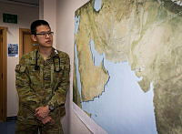 Royal Australian Air Force officer Flight Lieutenant Zu-Chuen inspects a map of the Middle East region in the Camp Baird medical centre at Australia's main operating base in the region on 4 April 2017.