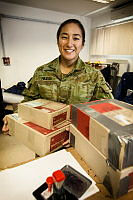 Australian Army soldier Corporal Vanessa Raz checks the mail for the troops deployed on Operation Highroad in Kabul, Afghanistan.