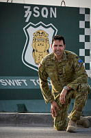 Sergeant Malcolm Mercieca, an Australian Army Ground Liaison Officer, is seen with the No 77 Squadron's T-wall artwork during his deployment to Middle East Region. The fighter/attack pilots of 77 Squadron RAAF were among the aircrew briefed by Sergeant Mercieca.