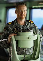 Lieutenant Patrick Velu stands on the bridge of HMAS Arunta whilst on Operation Manitou in the Middle East Region.