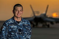 Royal Australian Air Force Corporal Chris Hendry a supplier from No 77 Squadron admires the sunset at the flight line during his Operation OKRA deployment to the main air operating base in the Middle East Region.