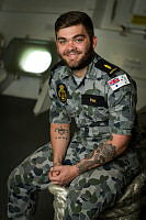Able Seaman Combat Systems Operator Toby Pink is seen in the Quarter Deck of HMAS Arunta.