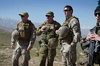 Australian Army officer Major John Spencer (centre) watches with his coalition partners as Afghan National Army Officer Academy cadets conduct a cordon and strike task at the Qargha training area.