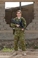 Australian Army soldier Corporal Melissah Triffet, deployed with Task Group Taji 4, stands near a dilapidated building at the Taji Military Complex in Iraq.
