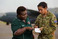 Australian Army soldier Private Laurelliza Morea talks with Mrs Alice Guguna from the Papua New Guinea Electoral Commision during Operation Hannah in Papua New Guinea.