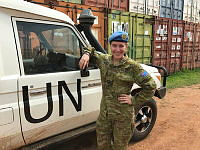 Flight Lieutenant Kelly Francis, deployed on Operation ASLAN, stands in front of a United Nations vehicle at the UN container storage yard in Juba, South Sudan.
