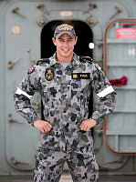 Able Seaman Combat Systems Operator Corey Evans stands on the flight deck of HMAS Newcastle whilst on Operation Manitou in the Middle East Region.