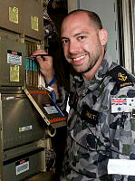 Leading Seaman Electronics Technician Matthew Shultz conducts planned maintenance on the SPS-55 Radar System onboard HMAS Newcastle in the Middle East region.