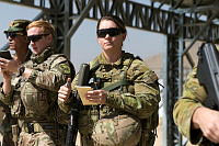 Australian Army Captain Gabriell Taylor (right) observes Afghan National Army Officer Academy training at Camp Qargha near Kabul, Afghanistan.