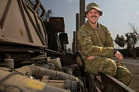 Australian Army soldier Lance Corporal Josh Leacy prepares to conduct checks on an Australian Army Unimog truck at the Taji Military Complex, Iraq, while serving on Operation Okra.