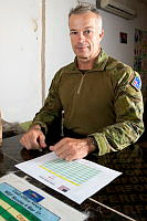 Australian Army officer Captain Martin Allen in the Task Group Taji cash office at the Taji Military Complex, Iraq.
