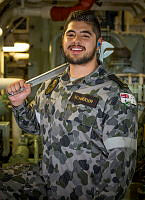 Able Seaman Marine Technician Erik Schneider is seen inside HMAS Warramunga's gas turbine room during the ships deployment to Operation MANITOU.