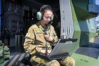 Australian Army Groundcrewman Mission Support Trooper Rebecca Draheim conducts diagnostic checks on a Multi Role Helicopter (MRH90) aircraft after a familiarisation training flight for the 2018 Commonwealth Games.