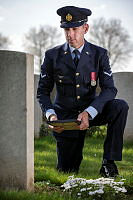 Royal Australian Air Force Leading Aircraftman Timothy Day kneels at the grave of his late Great-Grandfather, Private John Mooney, AIF, at the Vaulx Hill Field Ambulance Cemetery near Bapaume, France in the lead up to 2018 Anzac Day Commemorations.