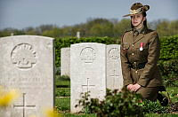 Australian Army soldier Musician Lenore Evans kneels by the grave of her relative, Private Duncan Lyal McKay, who was killed in action by an exploding shell on the 6th of June, 1918 and is buried at the Villers-Bretonneux Military Cemetery in France.