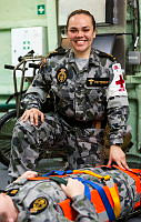 Able Seaman Medic Chelsey Patterson conducting medical training in the Flight Deck Triage compartment of HMAS Adelaide.
