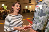 Policy Advisor to Indo-Pacific Endeavour 2018, Caitlyn Lane, speaks with Commander Joint Task Group Indo-Pacific Endeavour, Captain Jim Hutton, OBE, RAN, in the light vehicle deck on board HMAS Adelaide, during Indo-Pacific Endeavour 2018.