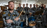 Royal Australian Navy Band drummer, Able Seaman Musician Nathan Hicks, with his band mates in HMAS Adelaide during Exercise RIMPAC 18.