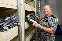 Royal Australian Navy sailor, Able Seaman Maritime Logistics - Supply Chain Linda Hannah, checks stocktake totals in the uniform store on board HMAS Success during Indo-Pacific Endeavour 2018.