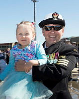Royal Australian Navy sailor, Petty Officer Maritime Logistics - Personnel Operations Lauren Birch, with daughter Rebecca, after HMAS Toowoomba arrives back to Fleet Base West, Western Australia, after deployment.