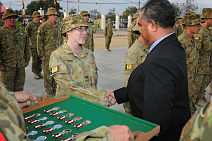 Corporal Joanne Wright shakes hands with Juan Corteria, Director General SED, during a parade at Fatu Hada, Dili, East Timor.