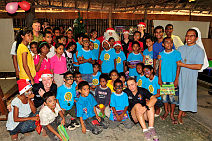 Australian Defence Force personnel join local children for the Orphanage Christmas Party held at Forward Operating Base Phoenix, Dili, Timor-Leste.