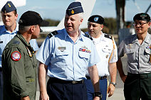 Commander Air Task Group, Group Captain Craig Heap (left), greets Vice Chief of the Defence Force, Air Marshal Mark Binskin, AC (centre) on his arrival at RAAF Base Pearce, Western Australia.