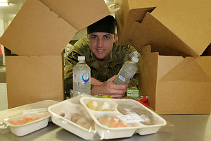 Leading Aircraftsman Daniel Thompson displays some of the product of the In-Flight Catering Facility at RAAF Base Tindal.