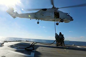 Royal Australian Navy Seahawk Helicopter 'Tiger 80' conducts in-flight refuelling training onboard HMAS Perth during Exercise Talisman Saber 2013.
