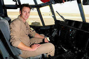 Flight Lieutenant Stephen Rothenbuhler in the cockpit of a C-130J Hercules after a flight from Afghanistan for Operation SLIPPER.