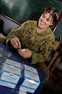 Australian Army environmental health officer, Captain Stacey Eason, sorts medications for dissemination to patients at the Cooperative Health Engagement at Tacloban as part of Exercise BALIKATAN.