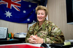 Sergeant Jill Bryant is photographed at her desk in the orderly room in Camp Baker, Kandahar Air Field, Afghanistan where she works as the Operations Cell Sergeant.