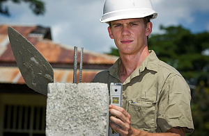 Australian soldier Sapper Bryan John, from 21 Construction Squadron, 6 Engineering Support Regiment, lays besser blocks at the new ablutions facility for the Farol Primary School in Dili, East Timor, during Exercise Pacific Partnership 2014.