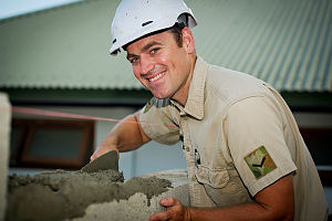 Australian soldier and electrician Lance Corporal Rhys Maddren, from 17 Construction Squadron, 6th Engineer Support Regiment, turns his hand to brick laying at the Comoro Health Centre, Dili, East Timor, during Exercise Pacific Partnership 2014.