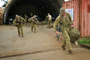 Australian Army soldiers from the 2nd Battalion, The Royal Australian Regiment, depart the French Armed Forces barracks in Plum, New Caledonia at the commencement of the Humanitarian Assistance and Disaster Relief phase of Exercise Croix du Sud.