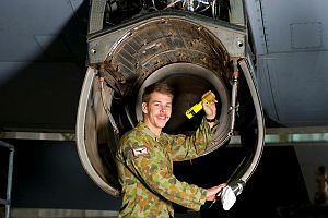 Royal Australian Air Force (RAAF) aircraft technician Leading Aircraftman Aaron Lawes, from No. 37 Squadron, inspects the engine housing of a RAAF C-130 Hercules aircraft on Operation Accordion in the United Arab Emirates.
