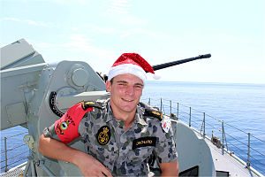 Electronic Technician, Able Seaman Ned Orchard on the forecastle of HMAS Huon.