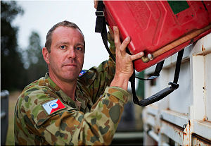 Corporal Justin May, from 13 Brigade, unloads stores in support of Operation Northcliffe Assist.