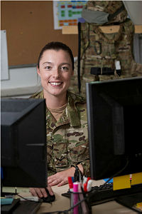 Australian Army soldier Lance Corporal Emily Lahey, a Coordination Clerk, is seen working at her desk in the Headquarters Joint Task Force 636 orderly room at Kabul, during her deployment on Operation Highroad as part of the NATO-led Resolute Support mission in Afghanistan.