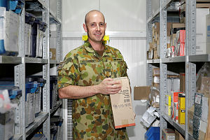 Royal Australian Air Force Corporal Paul Hockridge, a storemen with Joint Task Force 633, collects supplies to fill an order that will be shipped foward to Australian troops in the Middle East Region. Corporal Paul Hockridge is on his third overseas deployment and is involved with shipping stores throughout the region.