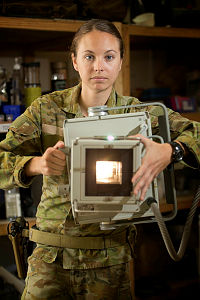 Australian Army radiographer Lieutenant Sarah Patterson adjusts the x-ray tube while setting up the x-ray machine in the medical facility at Taji Military Complex, Iraq. Lieutenant Patterson is deployed to Iraq as a radiographer to provide specialist care to Australian and New Zealand soldiers who are training Iraqi Security Forces as part of the Building Partner Capacity mission.