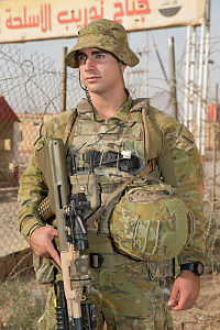 Australian Army soldier Private Anthony Russo provides force protection at the Taji Military Complex, Iraq. A company of infantryman, commonly referred to as Guardian Angels, provide force protection in order to insure training can be safely conducted.