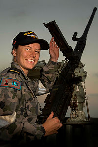 Royal Australian Navy sailor Seaman Boatswains Mate Jessica Muir maintains a .50cal machinegun aboard HMAS Melbourne, which is patrolling in the Middle East region as part of Operation Manitou.