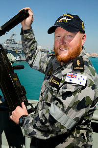 Royal Australian Navy sailor Able Seaman Boatswains Mate Troy Haydon, of HMAS Darwin, prepares for a patrol in the Middle East region from the Naval Support Activity base in Manama, Bahrain, during Operation Manitou.