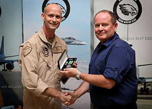 Mr Paul Etches is currently deployed to the Middle East region as a part of Operation OKRA. Paul works as the financial advisor for the Air Task Group and is the sole Australian Public Service member working within the Air Task Group. He is being presented the Australian Operational Service Medal - Greater Middle East Operation by Commander Air Task Group.