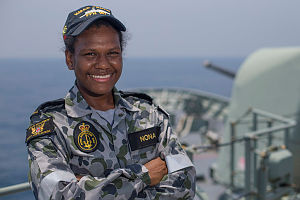 Able Seaman Boatswains Mate Esha Nona stands on HMAS Perth's forecastle as the ship sails through the Middle East Region on patrol for Operation MANITOU.