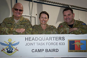 Royal Australian Air Force officer, Squadron Leader Bruce Chalmers (left), Air Task Group Public Affairs Officer, stands with his niece, Australian Army soldier, Corporal Jaye Griffin, a medic deploying to Task Group Taji in Iraq, and his nephew, Air Force Flight Sergeant Michael Thornely, a maintenance supervisor deployed with No. 75 Squadron Hornets, after they all met at the main reception and staging base in the Middle East Region.