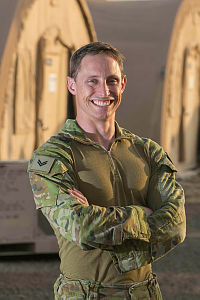 Communication Equipment Technician James Melville at Australia's main operating air base in the Middle East Region.